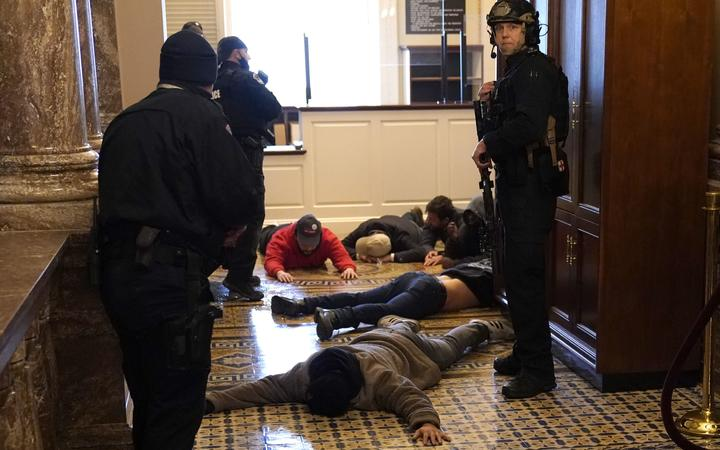 US Capitol Police detain protesters outside of the House Chamber during a joint session of Congress on January 06, 2021 in Washington, DC.