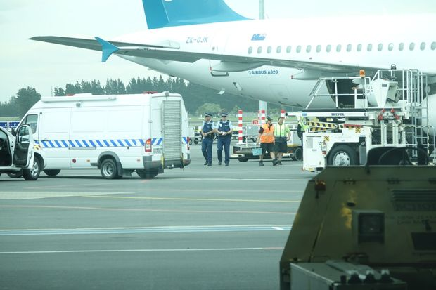 Police and airport staff at Christchurch Airport after white powder was found on an Air New Zealand flight.