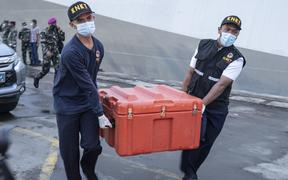 JAKARTA, INDONESIA - JANUARY 12: The National Transportation Safety Committee carry the Flight Data Recorder (blackbox) of Sriwijaya aircraft SJ 182 that crashed on January 12, 2021 in Jakarta, Indonesia.