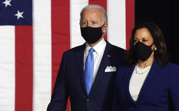 Democratic presidential nominee and former US Vice President Joe Biden (L) and vice presidential running mate, US Senator Kamala Harris, arrive to conduct their first press conference together in Wilmington, Delaware, on August 12, 2020.