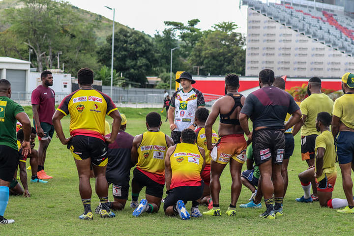 PNG Hunters coach Matt Church briefs training squad.