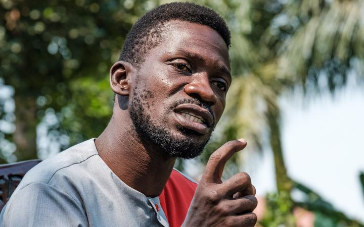 Musician turned politician Robert Kyagulanyi, aka Bobi Wine, addresses the media at his home in Wakiso, Uganda, on January 8, 2021 to announce his plans to take President Yoweri Museveni to the International Court Commission (ICC),