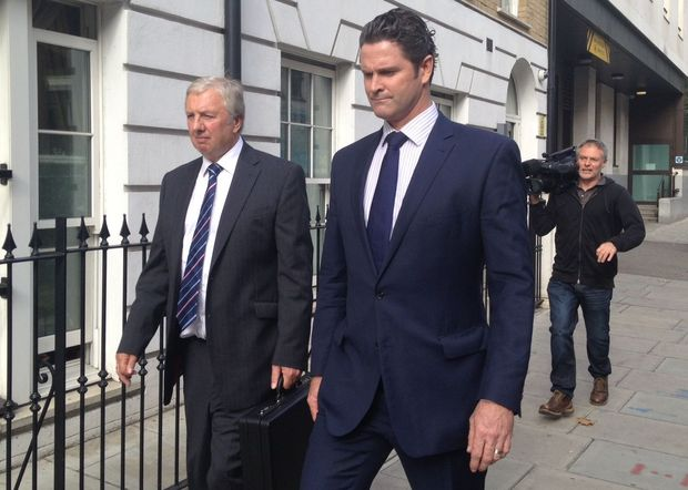Chris Cairns (right) and his lawyer Colin Nott leave Westminster Magistrates' Court after an earlier hearing.