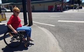 Wheelchair user Lisa Neil prepares to venture across Reefton's main drag:SH7 aka Broadway.