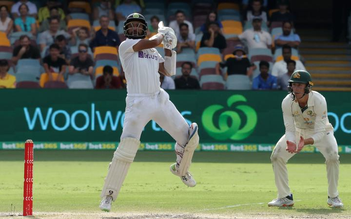 India's batsman Cheteshwar Pujara plays a shot on day five of the fourth cricket Test match between Australia and India at The Gabba in Brisbane on January 19, 2021.