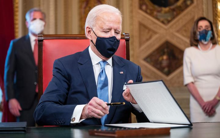 US President Joe Biden signs three documents including an Inauguration declaration, cabinet nominations and sub-cabinet noinations in the Presidents Room at the US Capitol after being sworn-in as the 46th president of the United States on January 20, 2021.