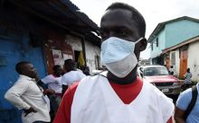 A Liberian health ministry employee visits the West Point district in Monrovia as part of an awareness campaign for Ebola.