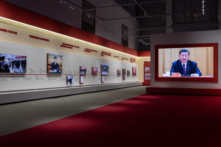 A video of China's President Xi Jinping plays on a large screen at an exhibition about China's fight against Covid-19. 15 January, 2021.