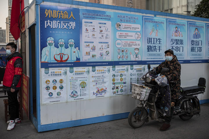 Information posters encouraging people to wash their hands and wear masks, outside a shopping mall in Wuhan. 13, January, 2021.