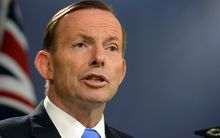 Australia's Prime Minister Tony Abbott speaks at a press conference in Sydney on 19 September 2014.