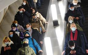 6446071 25.01.2021 People wearing protective face masks are seen in a subway amid coronavirus pandemic, in Moscow, Russia.