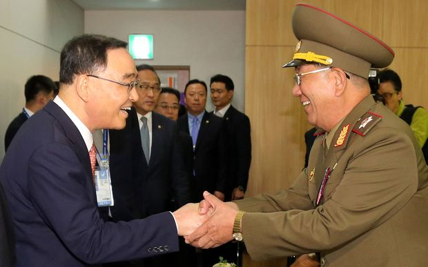 South Korean Prime Minister Chung Hong-Won (L) shakes hands with Hwang Pyong-So - director of the North Korea military's General Political Bureau.