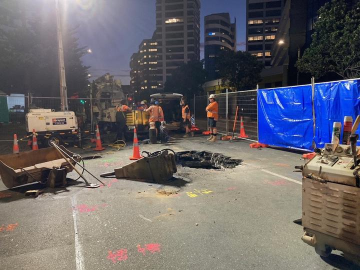 Wellington Water crews carried out a temporary repair to a stormwater pipe beneath Wellington's Jervois Quay.  a hole in the pipe is thought to have enabled water to gradually erode and wash away the subsoil.