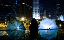 Pro-democracy demonstrators stood divided on Sunday over whether to withdraw from protest sites across Hong Kong.