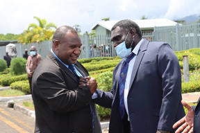Papua New Guinea's Prime Minister James Marape (left) arrives in Arawa for talks hosted by Bougainville's President, Ishmael Toroama (right) 5 February, 2021.