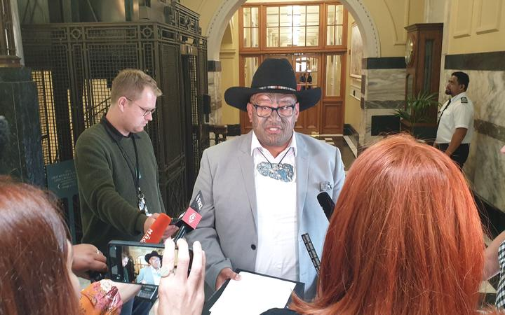 Rawiri Waititi speaks to media after being kicked out of the house by Speaker Trevor Mallard for not wearing a tie when asking questions.