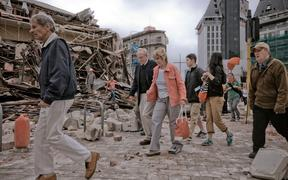 People walk through debris in the aftermath of the 22 February earthquake in Christchurch.
