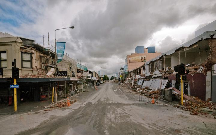 Rubble and damaged buildings line a deserted Colombo street in central Christchurch after the quake.