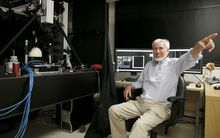 Professor John O'Keefe poses for pictures at his office in London after co-winning the Nobel Medicine prize.