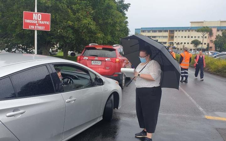 People queue for a Covid-19 test at Taranaki Base Hospital, where a line of cars hundreds of metres long snaked along Tukapa Street.