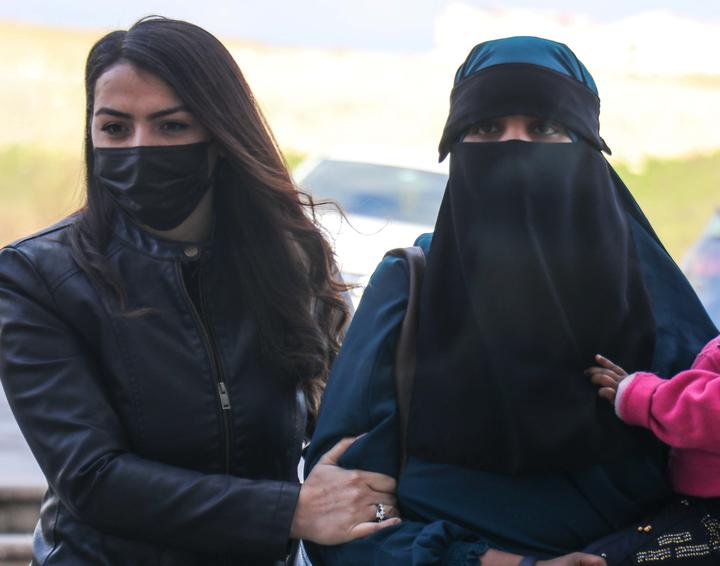 A 26-year-old New Zealand citizen, right, and two children were taken to court at Hatay under security measures. Turkye's Ministry of National Defence said they tried to enter from Syria illegally.