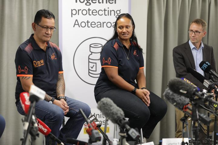 Jet Park worker Lynette Faiva (centre) was the first border worker to get vaccinated, Jet Park operations manager Drew Leafa (left) was the second, Director-General of Health Ashley Bloomfield is on the right.