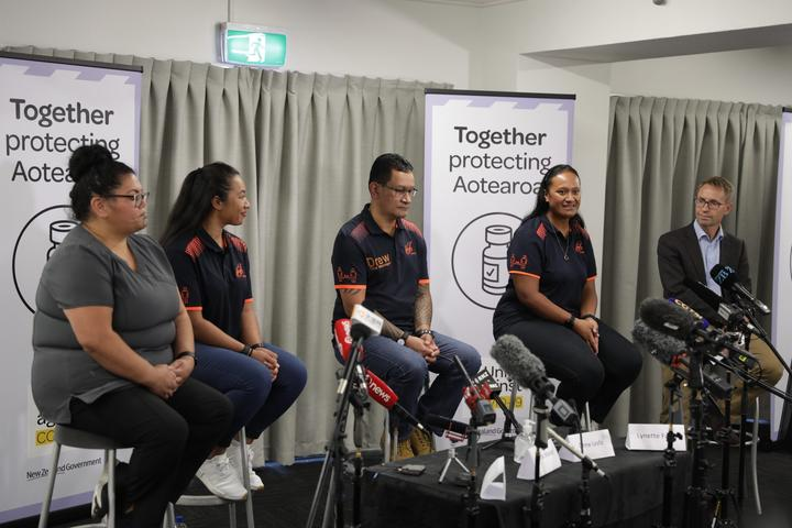 Some of the border workers to be vaccinated against Covid-19 and Director-General of Health Dr Ashley Bloomfield (right) at a media briefing.