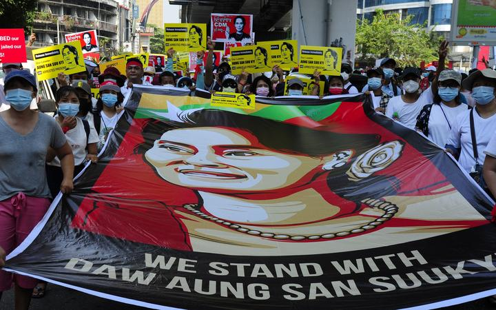 YANGON, MYANMAR - FEBRUARY 20: Anti-coup protesters hold picture of deposed leader Aung San Suu Kyi as they protest against the military coup Saturday, February 20, 2021, in Yangon, Myanmar.