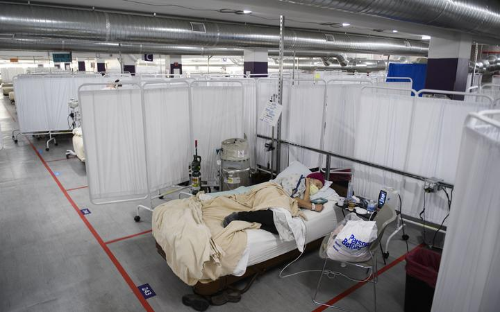 In this file photo taken on December 16, 2020 a patient rests in the Covid-19 alternative care site, built into a parking garage, at Renown Regional Medical Center, in Reno, Nevada.