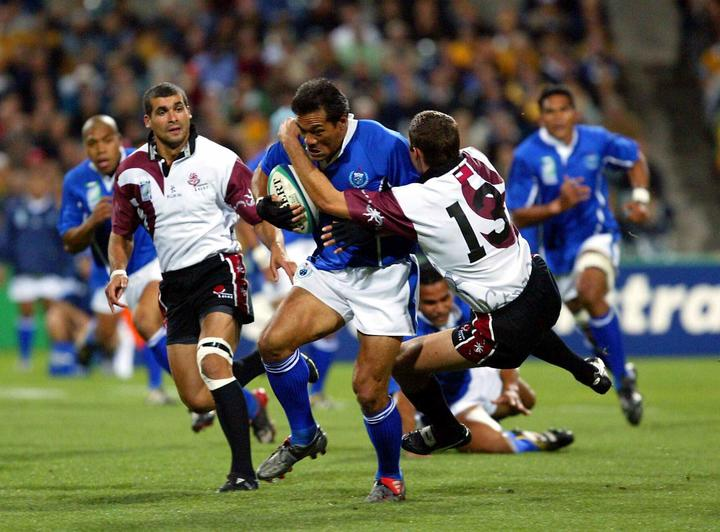 Manu Samoa's Brian Lima is tackled by the Georgian defence at the 2003 Rugby World Cup.