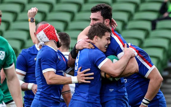 France's rugby captain Charles Ollivon celebrates after scoring a try.