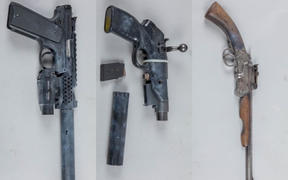 Three pistols and a set of ballistic armour were seized by police after a search warrant in Napier.