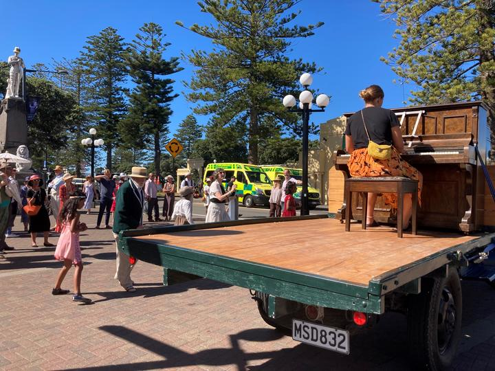 People dancing along to a piano tune by Marine Parade on Saturday to celebrate art deco without the festival.
