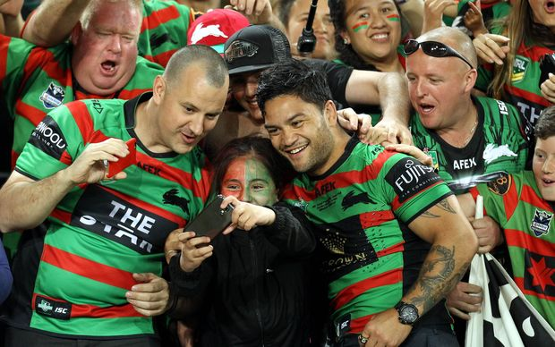 Isaac Luke celebrates with fans at the NRL Grand Final