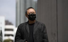 Pro-democracy activist Benny Tai arrives at Ma On Shan police station in Hong Kong, on Sunday 28 February 2021.