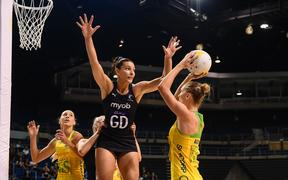 Kiera Austin of the Diamonds shoots under pressure from Karin Burger of the Silver Ferns.