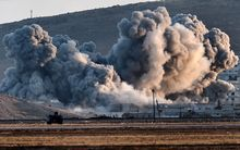 Smoke rises during US-led airstrikes on the Syrian town of Kobane.