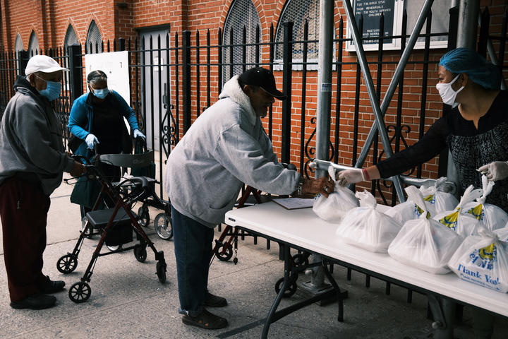 Meals are handed out at church in The Bronx, New York City. The area has long struggled with poverty, but been especially impacted by the Covid-19 pandemic.