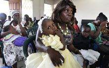 Women and children attending a mass in Monrovia for Ebola victims last month. Liberia's capital has been the hardest hit.