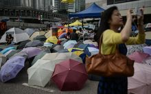 A pile of umbrellas on a road occupied by pro-democracy protesters in the Admiralty district of Hong Kong.