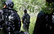 State police guard a mass grave that was found earlier this month near Iguala in Guerrero state.