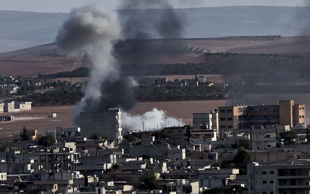 Smoke rises after an air strike on Kobane, which has seen Islamic State fighters' control of the Syrian town severely dented.