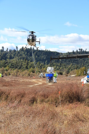 A bait bucket being refilled during an aerial 1080 operation in the Tongariro Conservation Area