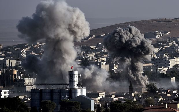 Smoke from US-led airstrikes on Islamic State militants in Kobane which has been a battleground for IS and Kurds for three weeks.