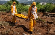 Funeral agents who specialise in the burial of Ebola victims at a cemetery in Freetown in Sierra Leone.