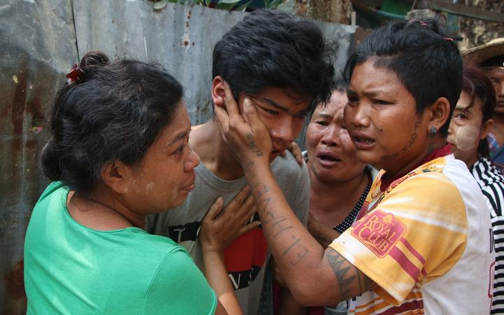 YANGON, MYANMAR - MARCH 27: Relatives mourn at the funeral of a person, who was killed during a demonstration against the military coup in Yangon, Myanmar on March 27, 2021.