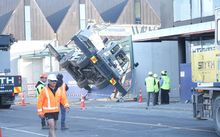 A crane on a construction site in Christchurch crashes and closes Victoria street.