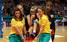 Casey Kopua leaves the court after suffering a serious knee injury playing against Australia, Sydney 2014.