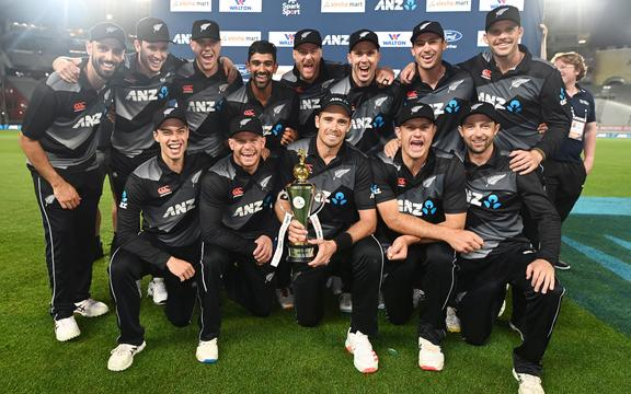 The Black Caps celebrate with the series trophy.