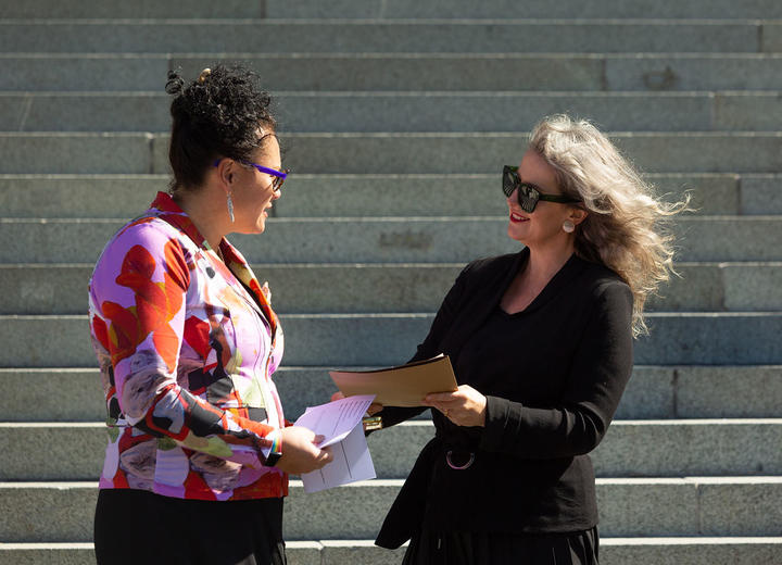 MP Louisa Wall receives the petition from Gender Justice Collective's Angela Meyer in front of Parliament this afternoon.